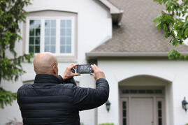 Contractor capturing a photo